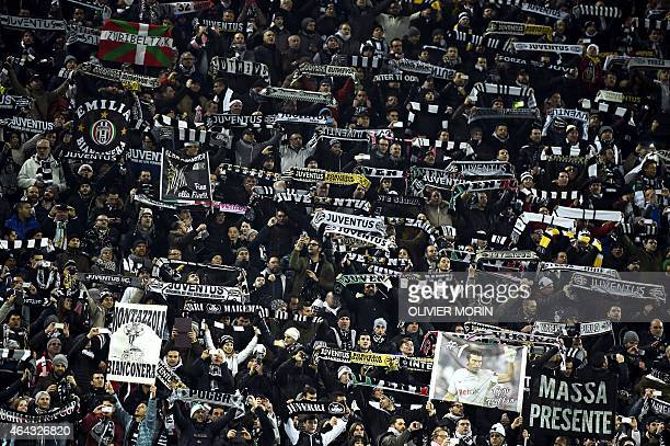 Juventus' supporters react the UEFA Champions League round of 16 first leg football match Juventus vs Borussia Dortmund at the Juventus stadium in...