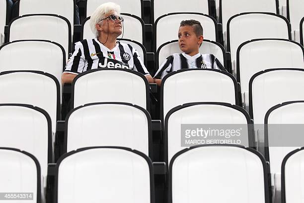 Juventus supporters wait for the start of the UEFA Champions League football match Juventus vs Malmo at 'Juventus Stadium' in Turin on September 16...