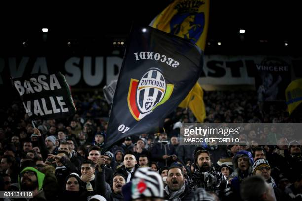 Juventus' supporters wave flags during the Italian Serie A football match Juventus vs Inter Milan on February 5 2017 at the Juventus Stadium in Turin...