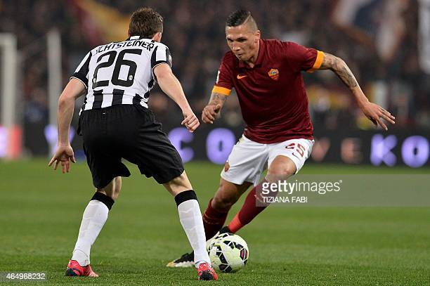 Juventus' Swiss defender Stephan Lichtsteiner vies for the ball with Roma's Greek defender Jose Holebas during the Italian Serie A football match...
