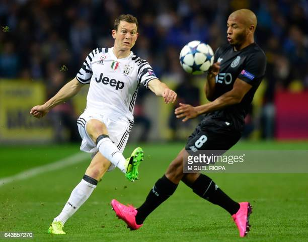 Juventus' Swiss defender Stephan Lichtsteiner vies with Porto's Algerian forward Yacine Brahimi during the UEFA Champions League round of 16 second...