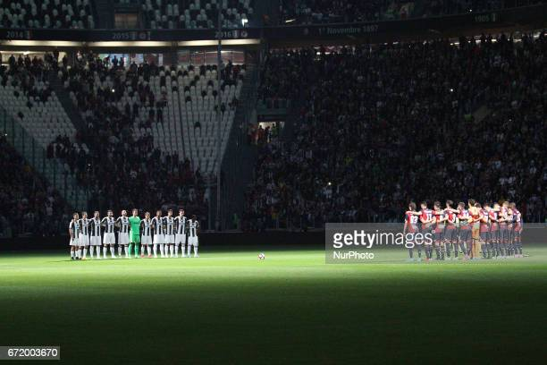 Juventus team and Genoa team stand in memory of Michele Scarponi before the Serie A football match n33 JUVENTUS GENOA on at the Juventus Stadium in...