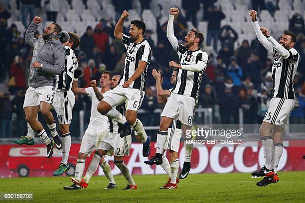 Juventus' team celebrate at the end of the Italian Serie A football match Juventus vs As Roma on December 17 2016 at the 'Juventus Stadium' in Turin...