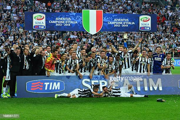 Juventus' team celebrates with the Scudetto the Italian Serie A trophy during a ceremony after the Italian Serie A football match between Juventus...