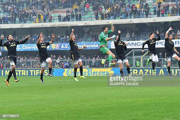 TOPSHOT Juventus' team jump to celebrate at the end of the Serie A football match between Chievo Verona and Juventus at Bentegodi Stadium in Verona...