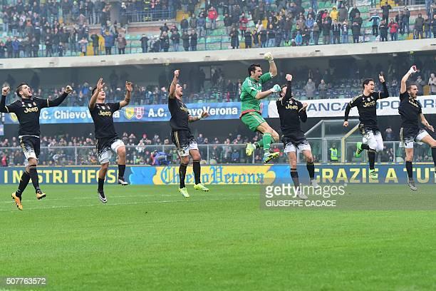 TOPSHOT Juventus' team jump to celebrate at the end of the Serie A football match between Chievo Verona and Juventus at Bentegodi Stadium in Verona...