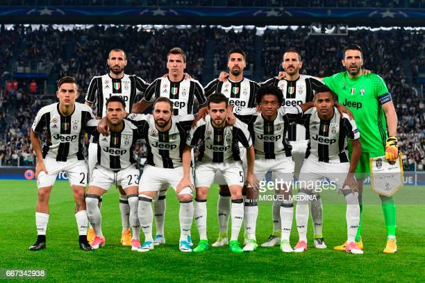 Juventus team players Juventus' defender from Italy Giorgio Chiellini Juventus' forward from Croatia Mario Mandzukic Juventus' midfielder from...