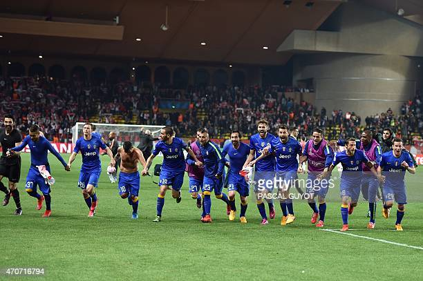 Juventus' teammates celebrate after qualifying for the semifinals of the UEFA Champions League following the quarter final second leg football match...