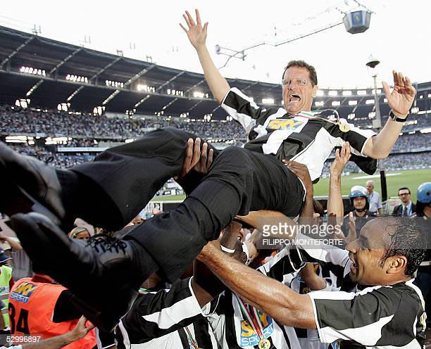 Juventus trainer Fabio Capello is lifted by his players after the last Serie A football match of the season against Cagliari in Turin's Delle Alpi...
