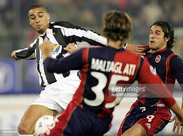 Juventus Turin French forward David Trezeguet vies with Roberto Maltagliati and Francesco Bega of Cagliari during their Italian Serie A football...