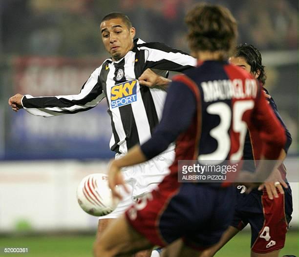 Juventus Turin French forward Trezeguet David vies with Maltagliati Roberto of Cagliari during their Italian Serie A football match at StEliaa...