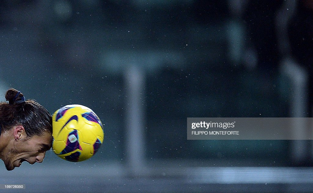 Juventus' Uruguaian defender Martin Caceres heads the ball against Udinese during their Serie A football match in Turin's Juventus Stadium on January 19, 2013. AFP PHOTO / FILIPPO MONTEFORTE