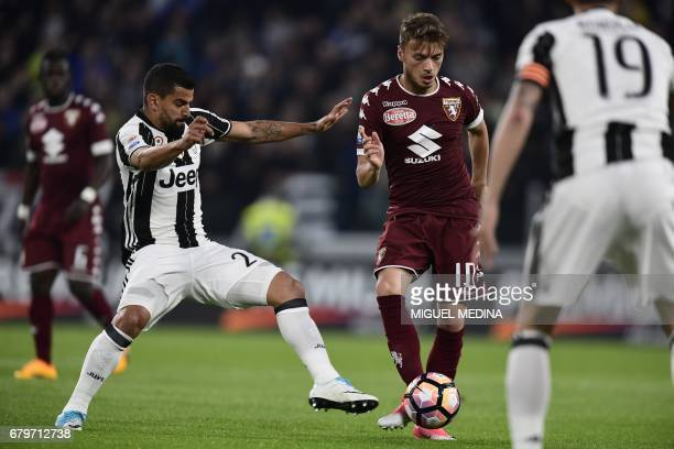 Juventus' Venezuelian midfielder Tomas Rincon vies with Torino's Serbian forward Adem Ljajic during the Italian Serie A football match Juventus vs...