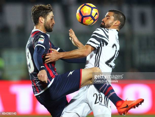 Juventus' Venzulan midfielder Tomas Rincon fights for the ball with Crotone's Italian midfielder Andrea Barberis during the Italian Serie A football...