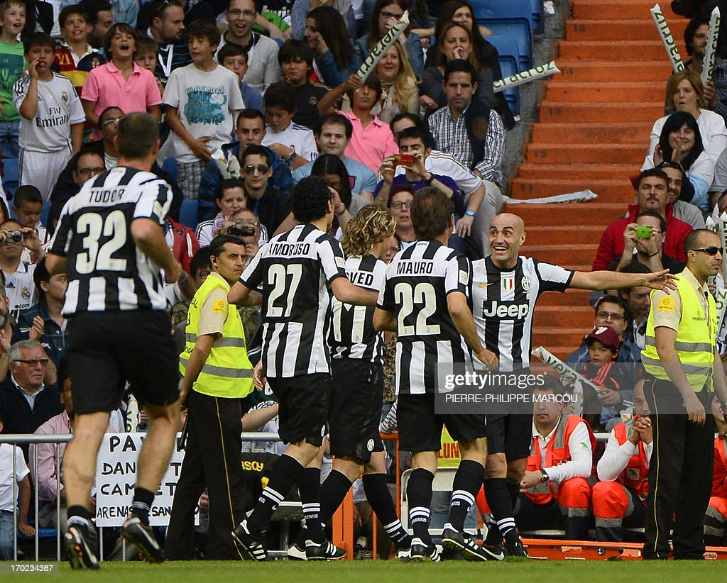 Juventus veteran's Paolo Montero (R) celebrates with teammates after scoring during the Corazon Classic Match 2013 - Veracruz charity football match Real Madrid Legends vs Juventus Turin Veterans at the Santiago Bernabeu stadium in Madrid on June 9, 2013. AFP PHOTO/ PIERRE-PHILIPPE MARCOU