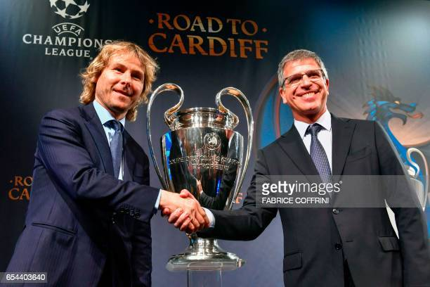Juventus' Vice Chairman Pavel Nedved shakes hands with FC Barcelona's Vice President Jordi Mestre following the quarterfinal draw for the UEFA...