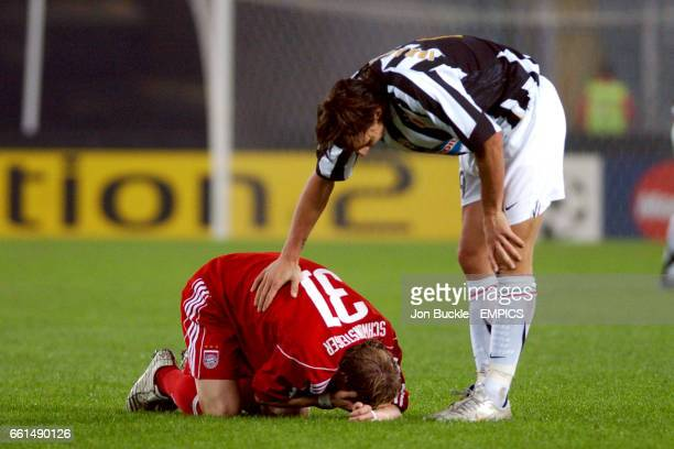 Juventus' Zlatan Ibrahimovic checks on Bayern Munich's Bastian Schweinsteiger after he was kicked in the face