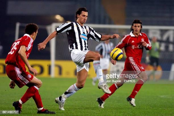 Juventus' Zlatan Ibrahimovich gets between Bayern Munich's Sebastian Diesler and Martin Demichelis