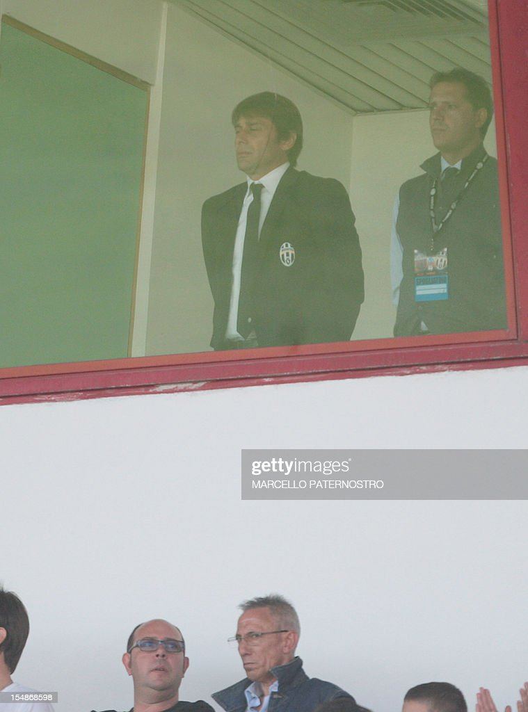 Juventus's coach Antonio Conte serving a four month 'Calcioscommesse' matchfixing ban stands in the tribune during the Italian Serie A football match...