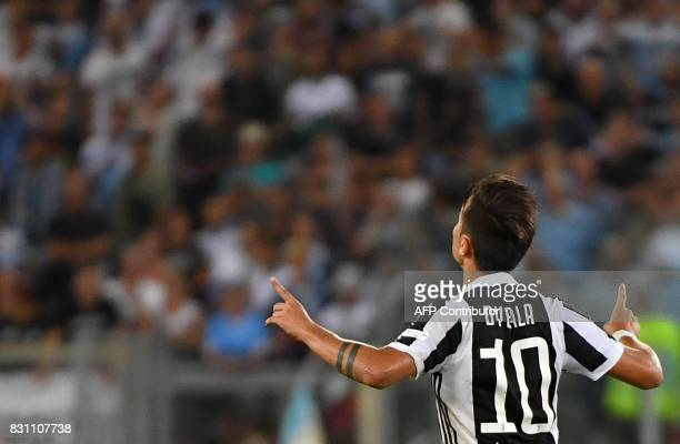 Juventus's forward from Argentina Paulo Dybala celebrates after scoring during the Italian SuperCup TIM football match Juventus vs lazio on August 13...
