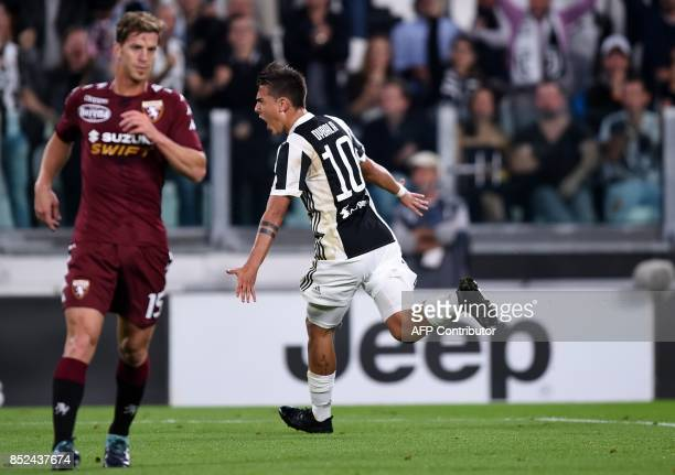 Juventus's forward from Argentina Paulo Dybala celebrates after scoring during the italian Serie A football match Juventus vs Torino at the Allianz...