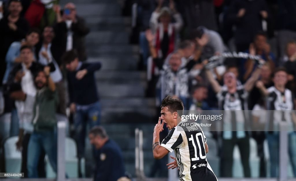 Juventus's forward from Argentina Paulo Dybala celebrates after scoring during the italian Serie A football match Juventus vs Torino at the Allianz Stadium in Turin on September 23, 2017. /
