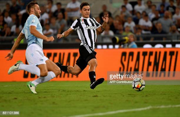 Juventus's forward from Argentina Paulo Dybala fights for the ball with Lazio's defender from Netherlands Stefan de Vrij during during the Italian...