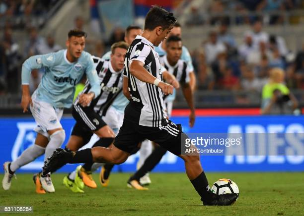Juventus's forward from Argentina Paulo Dybala kicks and scores a penalty during the Italian SuperCup TIM football match Juventus vs lazio on August...