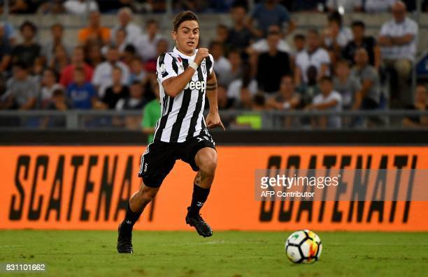 Juventus's forward from Argentina Paulo Dybala runs for the ball during the Italian SuperCup TIM football match Juventus vs lazio on August 13 2017...