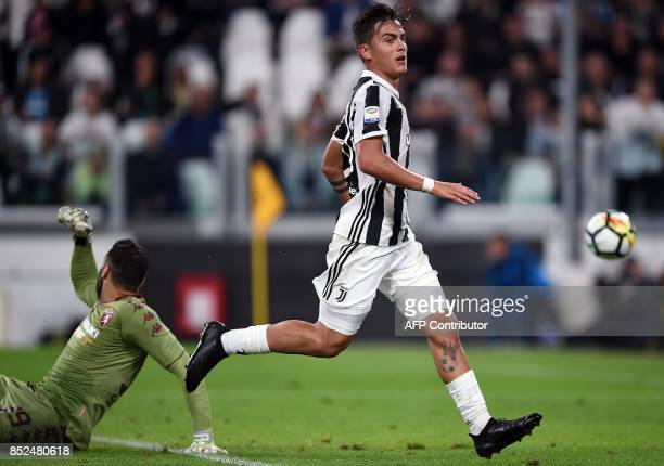 Juventus's forward from Argentina Paulo Dybala scores a goal to Torino italian goalkeeper Salvatore Sirigu during the italian Serie A football match...