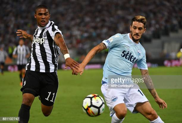 Juventus's forward from Brazil Douglas Costa fights for the ball with Lazio's midfielder from Spain Luis Alberto during the Italian SuperCup TIM...