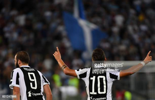 Juventus's forward from France Gonzalo Higuain and Juventus's forward from Argentina Paulo Dybala celebrate after scoring during the Italian SuperCup...
