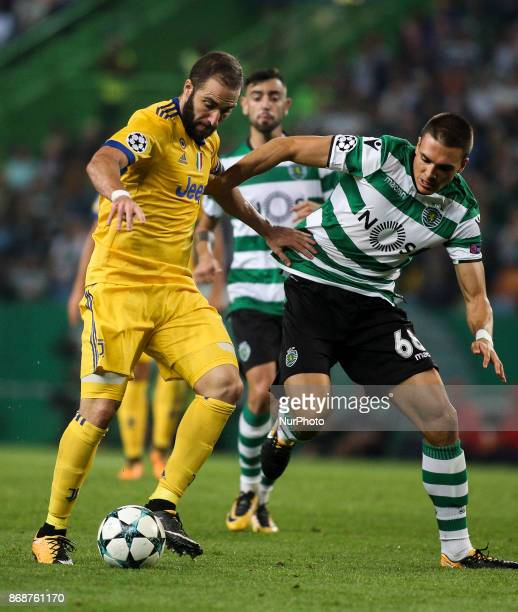 Juventus's forward Gonzalo Higuain vies with Sporting's midfielder Joao Palhinha during the Champions League football match between Sporting CP and...