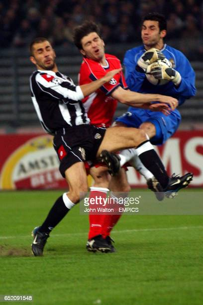 Juventus's Marco Di Vaio goes in on Deportivo La Coruna's goalkeeper Juanmi and Hector