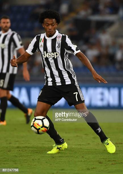 Juventus's midfielder from Colombia Juan Cuadrado controls the ball during the Italian SuperCup TIM football match Juventus vs lazio on August 13...