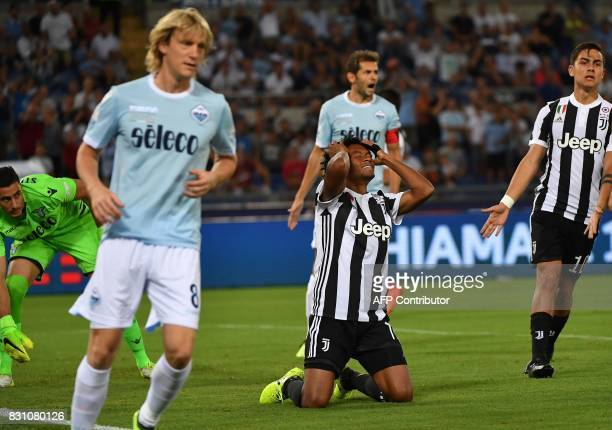 Juventus's midfielder from Colombia Juan Cuadrado reacts next to Lazio's defender from Serbia Dusan Basta during the Italian SuperCup TIM football...