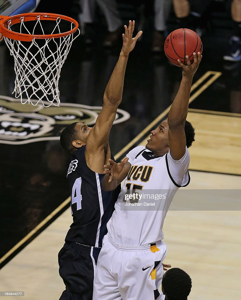 Juvonte Reddic #15 shoots over Zeke Marsahll #44 of the VCU Rams of the Akron Zips during the second round of the 2013 NCAA Men's Basketball Tournament at The Palace of Auburn Hills on March 21, 2013 in Auburn Hills, Michigan. VCU defeated Akron 88-42.