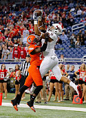 Juwan Brescacin of the Northern Illinois Huskies catches a four yard touchdown pass as Will Watson of the Bowling Green Falcons defends during the...