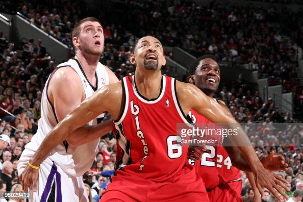 Juwan Howard and Martell Webster of the Portland Trail Blazers box out Spencer Hawes of the Sacramento Kings during the game at The Rose Garden on...