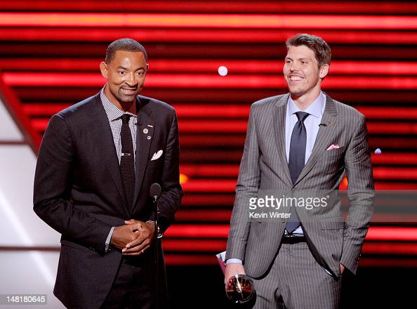Juwan Howard and Mike Miller of the NBA Miami Heat win the award for Best Team onstage during the 2012 ESPY Awards at Nokia Theatre LA Live on July...