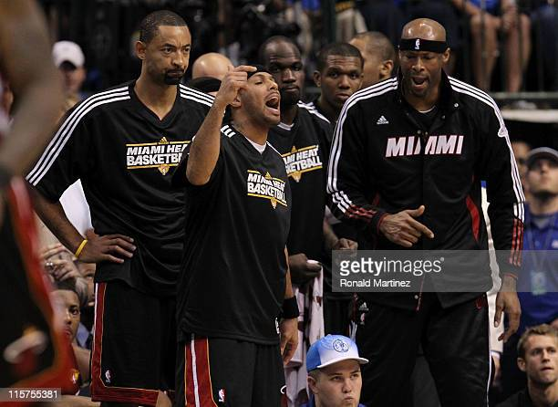 Juwan Howard Eddie House Joel Anthony James Jones and Erick Dampier of the Miami Heat react on the bench against the Dallas Mavericks in the fourth...