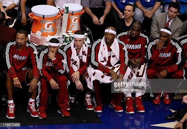 Juwan Howard Eddie House Mike Bibby Erick Dampier Joel Anthony and LeBron James of the Miami Heat sit on the bench while taking on the Dallas...