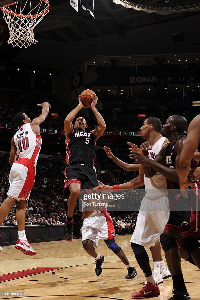 <a gi-track='captionPersonalityLinkClicked' href=/galleries/search?phrase=Juwan+Howard&family=editorial&specificpeople=201642 ng-click='$event.stopPropagation()'>Juwan Howard</a> #5 of the Miami Heat shoots against DeMar DeRozan #10 of the Toronto Raptors during a game on April 13, 2011 at the Air Canada Centre in Toronto, Ontario, Canada.