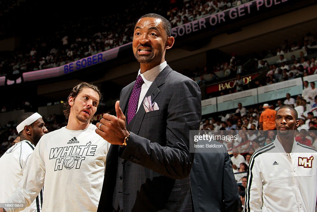 Juwan Howard #5 of the Miami Heat smiles on the sideline as his teammates play the Indiana Pacers in Game One of the Eastern Conference Finals during the 2013 NBA Playoffs on May 22, 2013 at American Airlines Arena in Miami, Florida.