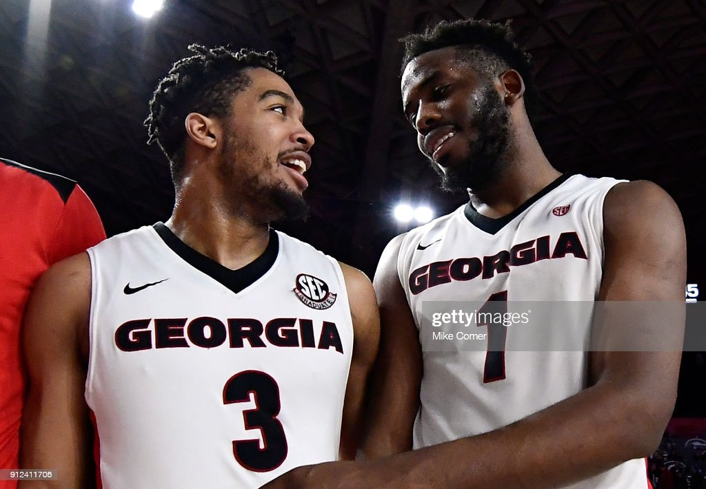 Juwan Parker #3 and Yante Maten #1 of the Georgia Bulldogs celebrate following a win over the Florida Gators after the basketball game at Stegeman Coliseum on January 30, 2018 in Athens, Georgia.