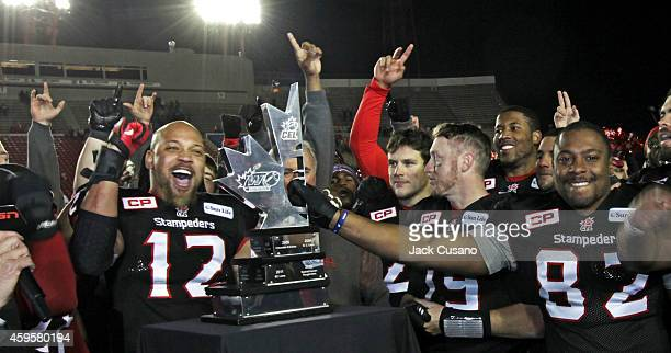 Juwan Simpson from Calgary Stampeders and Nik Lewis celebrate after Calgary beat the Edmonton Eskimos during the divisional finals at McMahon Stadium...