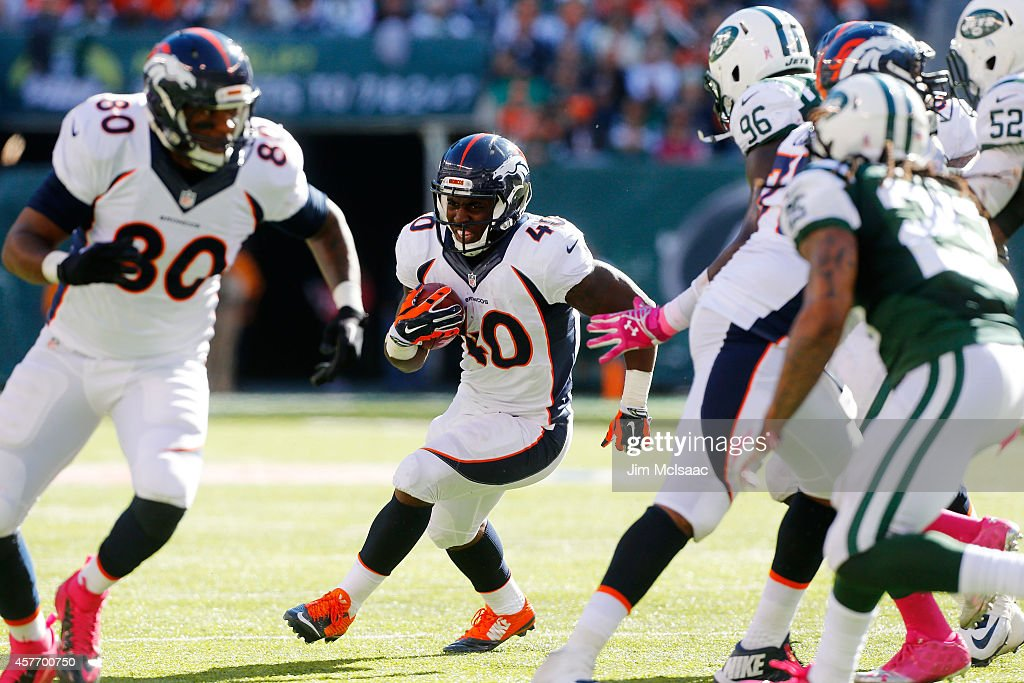 <a gi-track='captionPersonalityLinkClicked' href=/galleries/search?phrase=Juwan+Thompson&family=editorial&specificpeople=7210888 ng-click='$event.stopPropagation()'>Juwan Thompson</a> #40 of the Denver Broncos in action against the New York Jets on October 12, 2014 at MetLife Stadium in East Rutherford, New Jersey. The Broncos defeated the Jets 31-17.