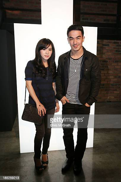 Juwita Liana and Joe Taslim attend the Burberry Brit Rhythm Men gig at 28 Lorong Ampas in Singapore on October 18 2013 in Singapore