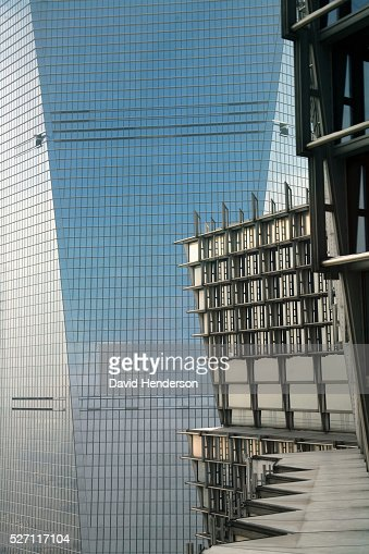 Juxtaposition of two skyscrapers : Stock Photo
