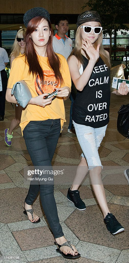 Juyeon and Lizzy of South Korean girl group After School are seen on departure at Gimpo International Airport on July 23, 2013 in Seoul, South Korea.